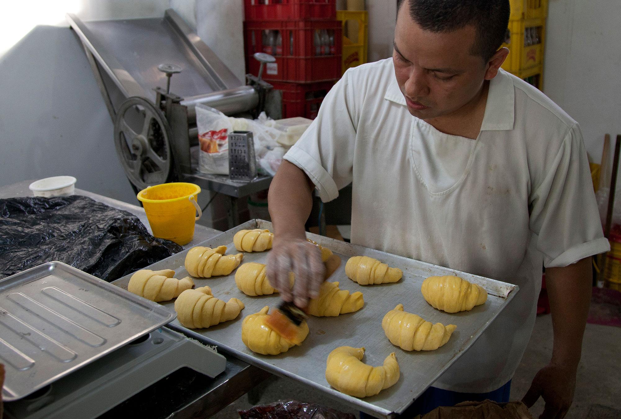 Man working in a bakery near Barranquilla, Colombia.