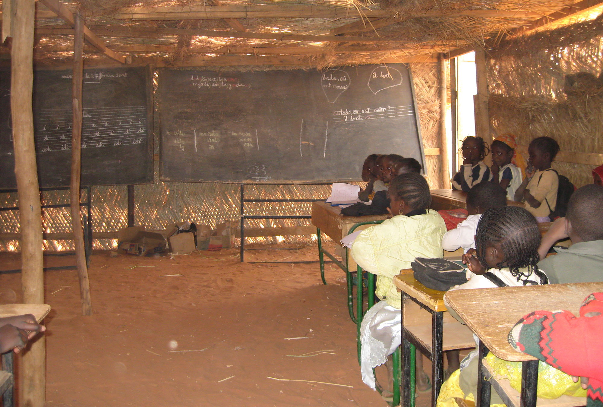 Children in classroom with blackboard