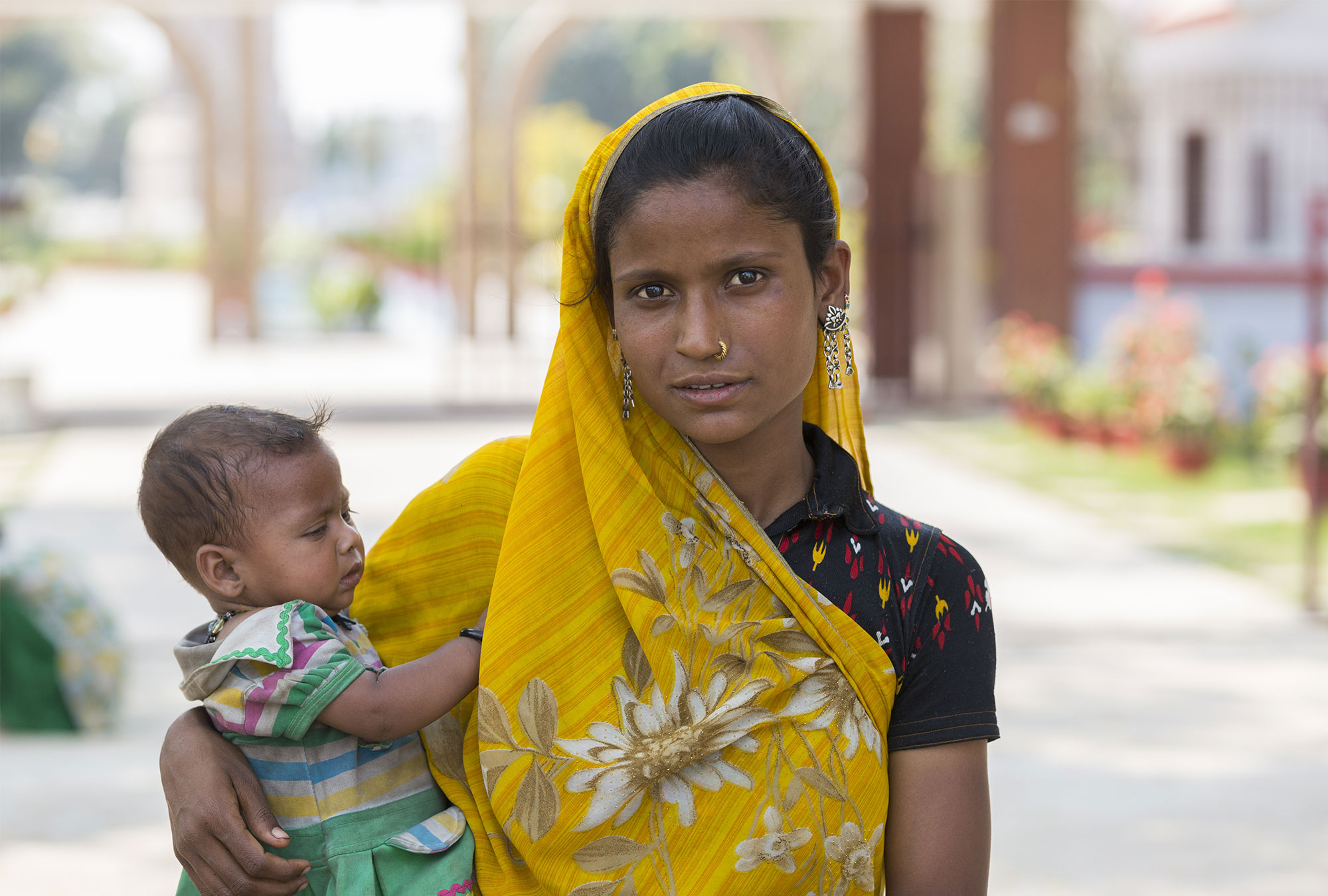 Indian woman holds her baby