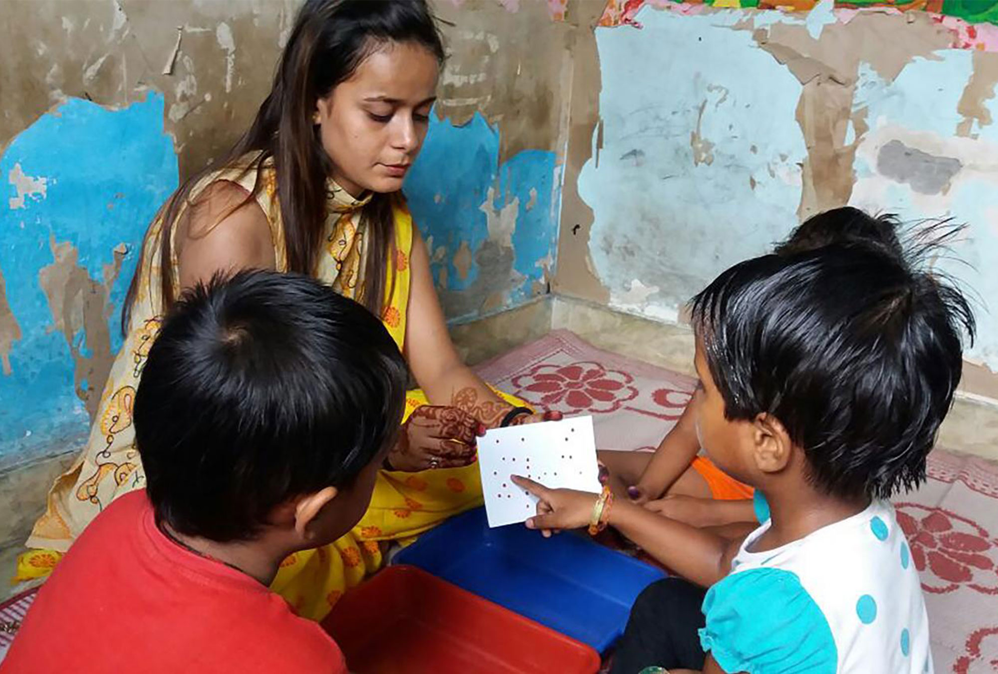 Woman shows games to children