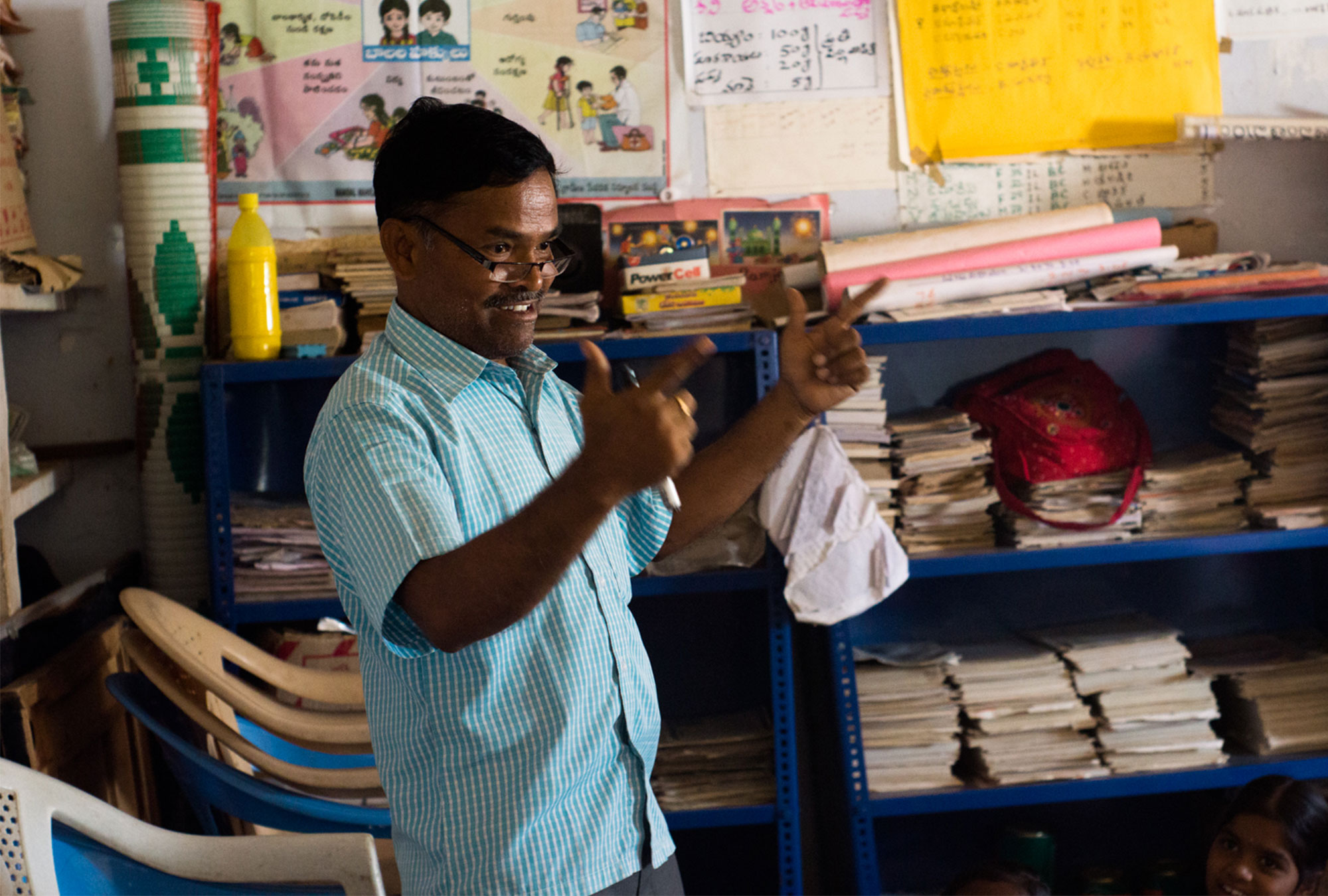 A teacher gives a lively lecture to students