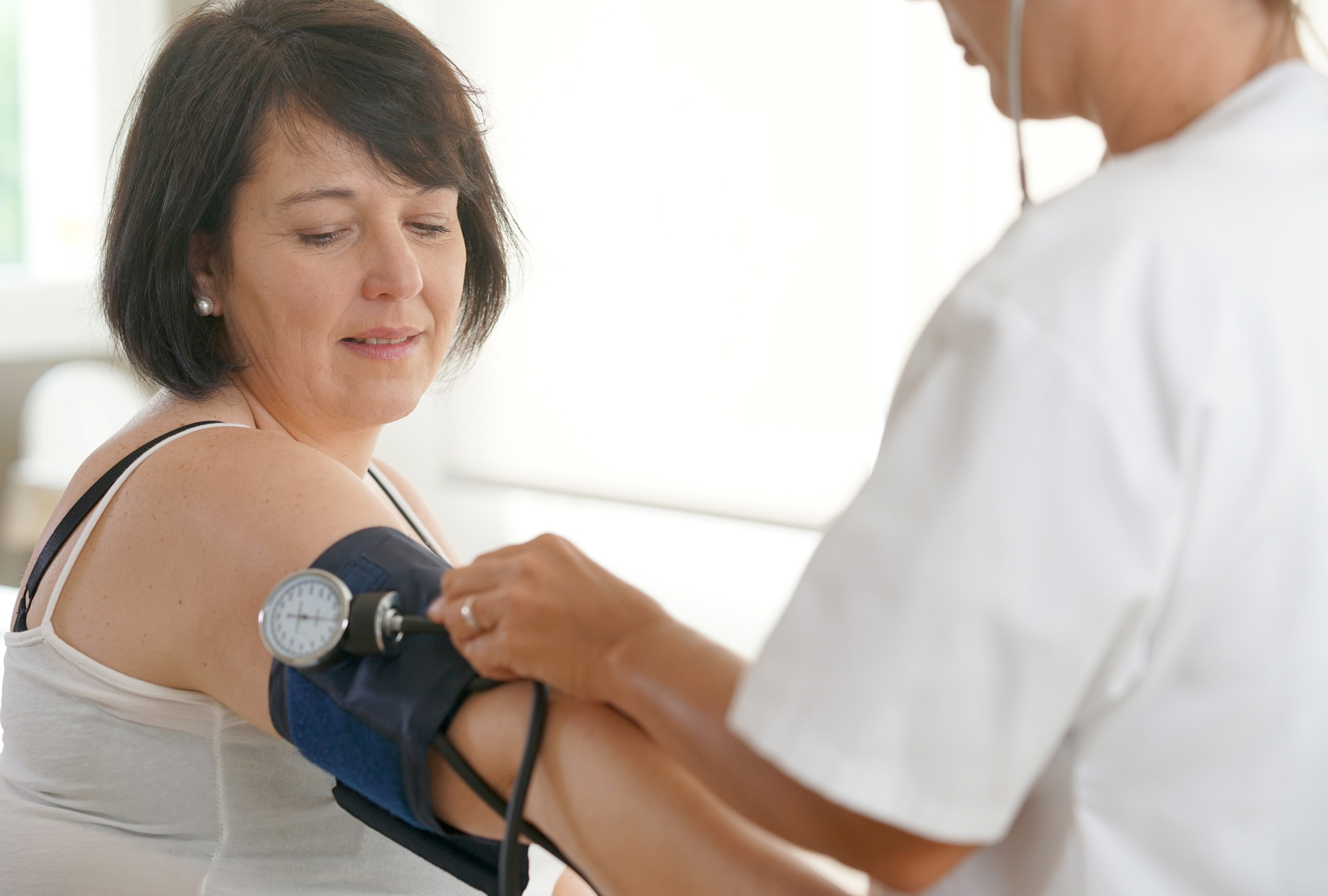 Woman getting her blood pressure measured