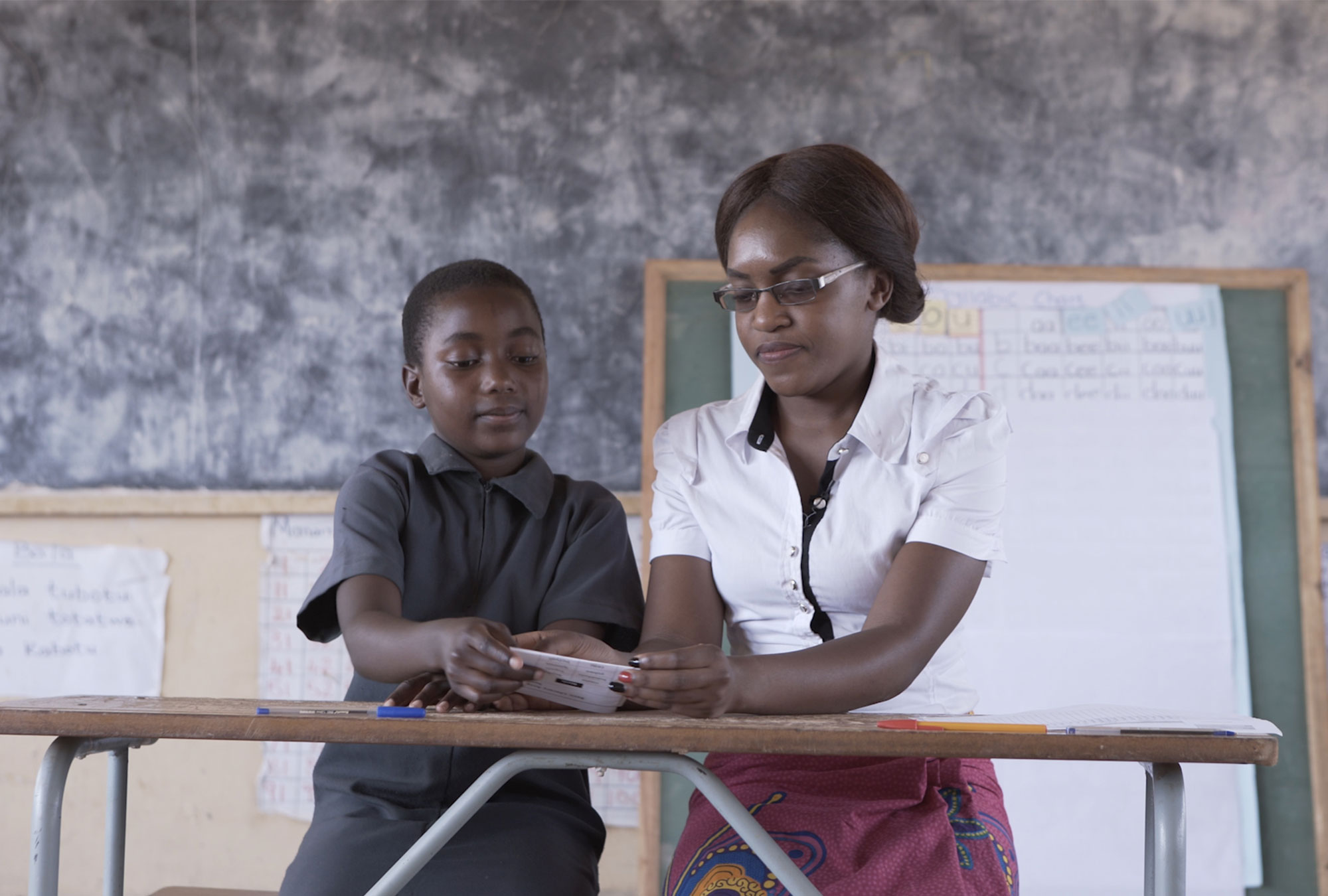 Teacher and child perform assessment