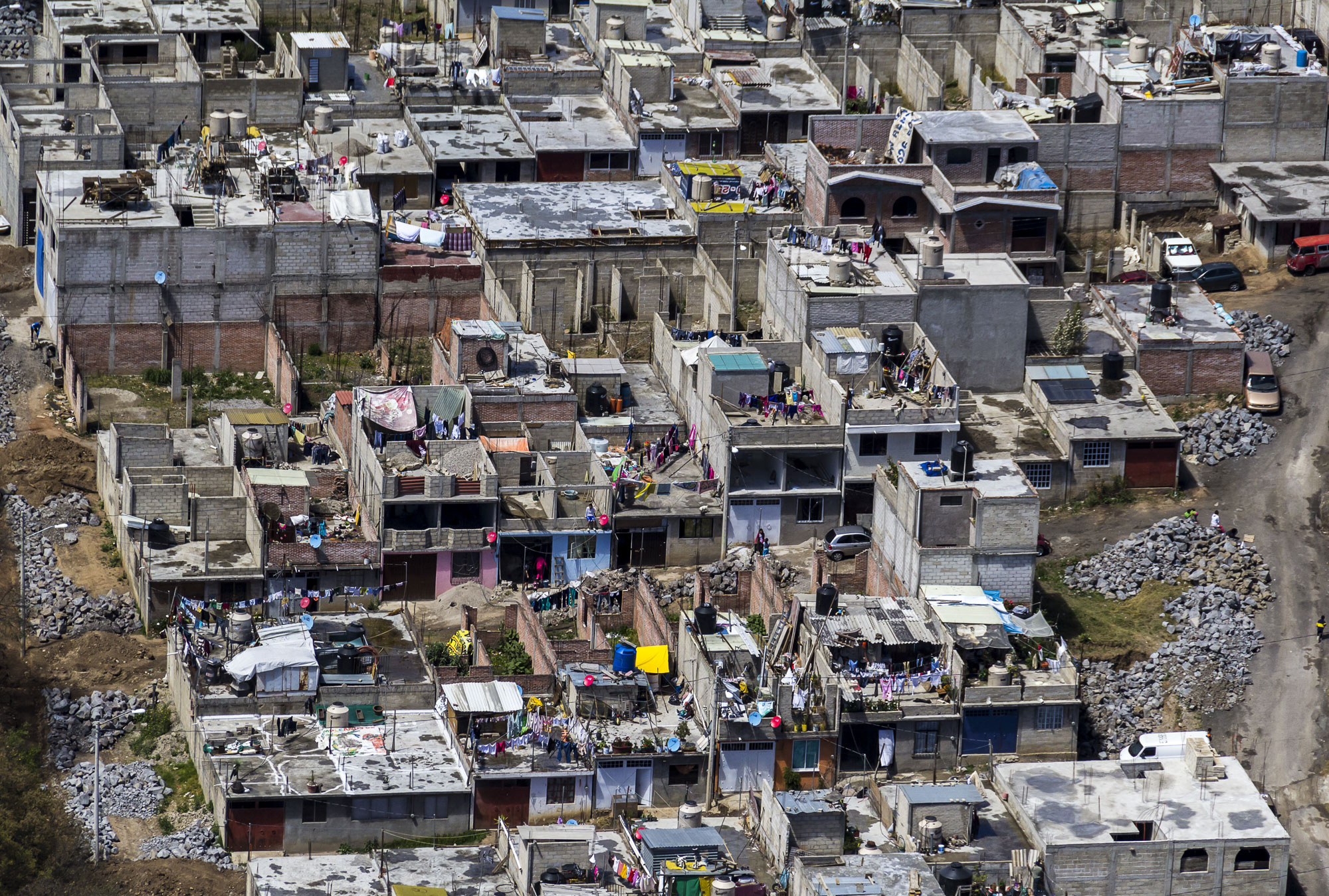 a definition of slum Slum meaning: 1 a very poor and crowded area, especially of a city: 2 a very untidy or dirty place: 3 to spend time in conditions that are much less good than the standard that you are used to:  learn more.