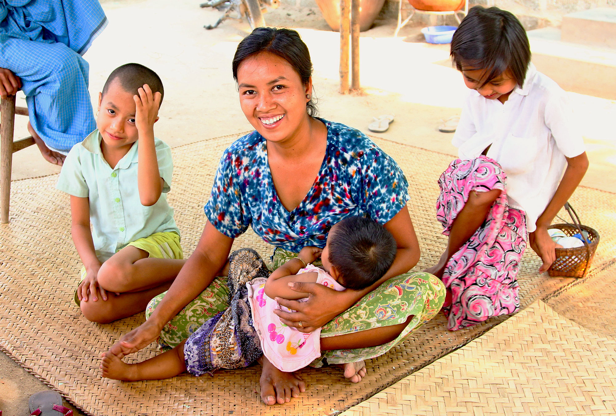 Smiling woman with three children