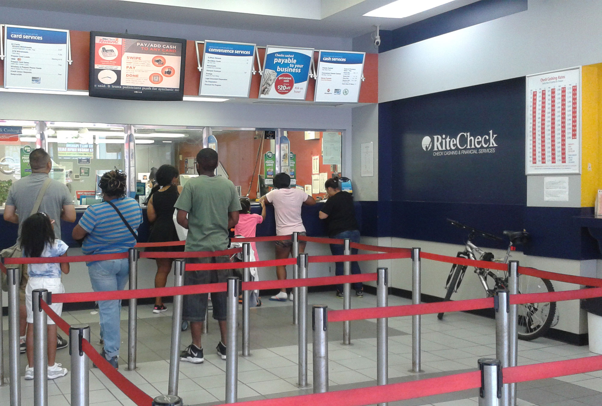 People stand in line at check cashing facility