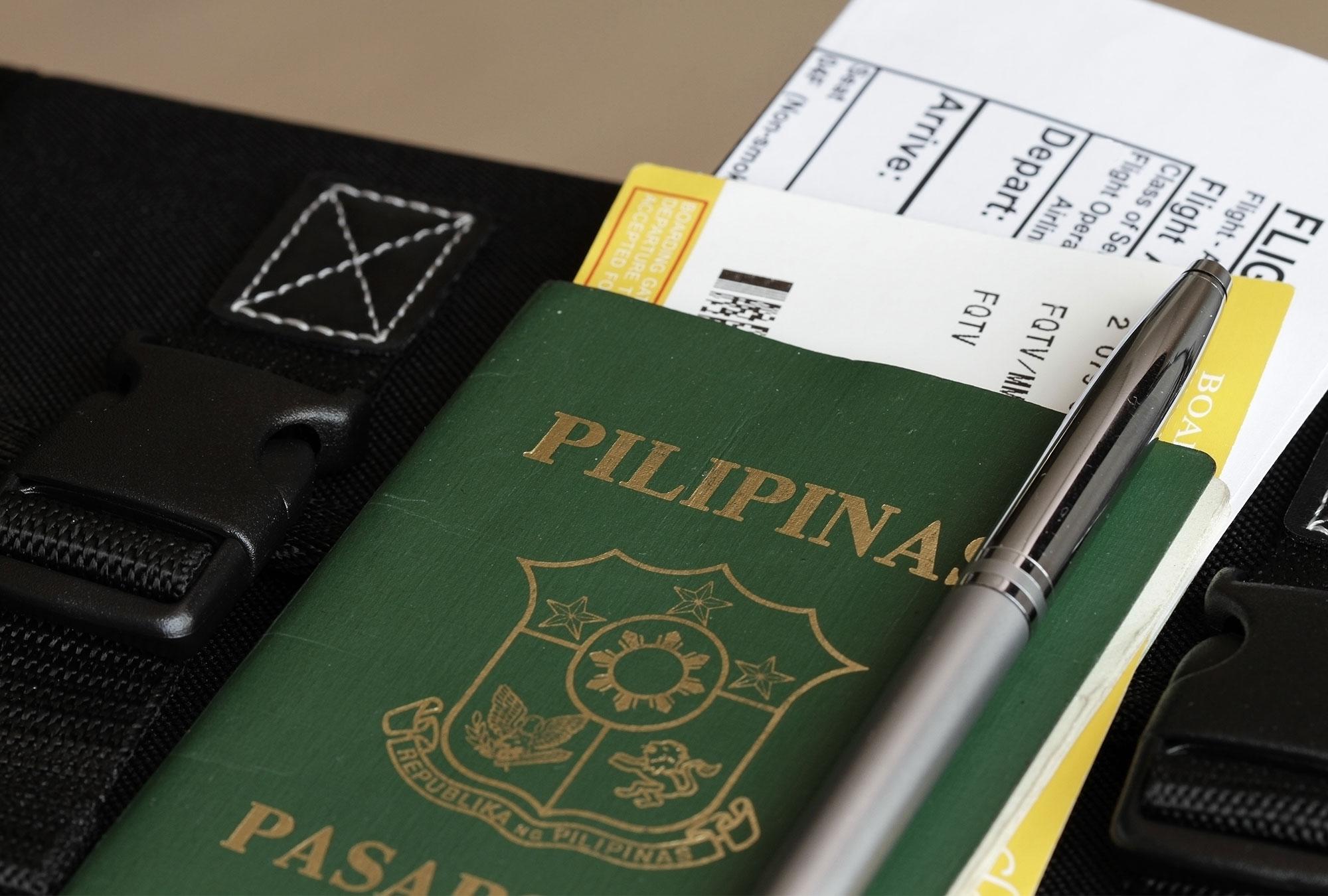 Pilipinas passport with flight ticket inside