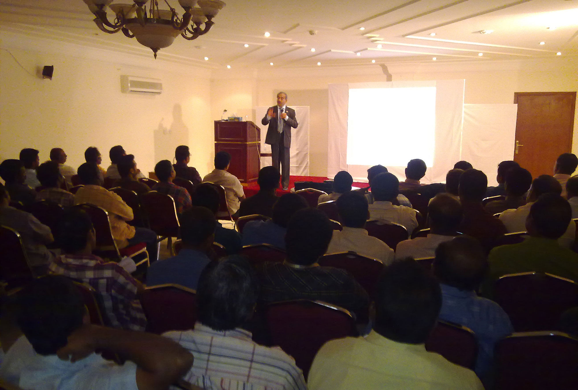 Training session for migrant workers in Qatar.