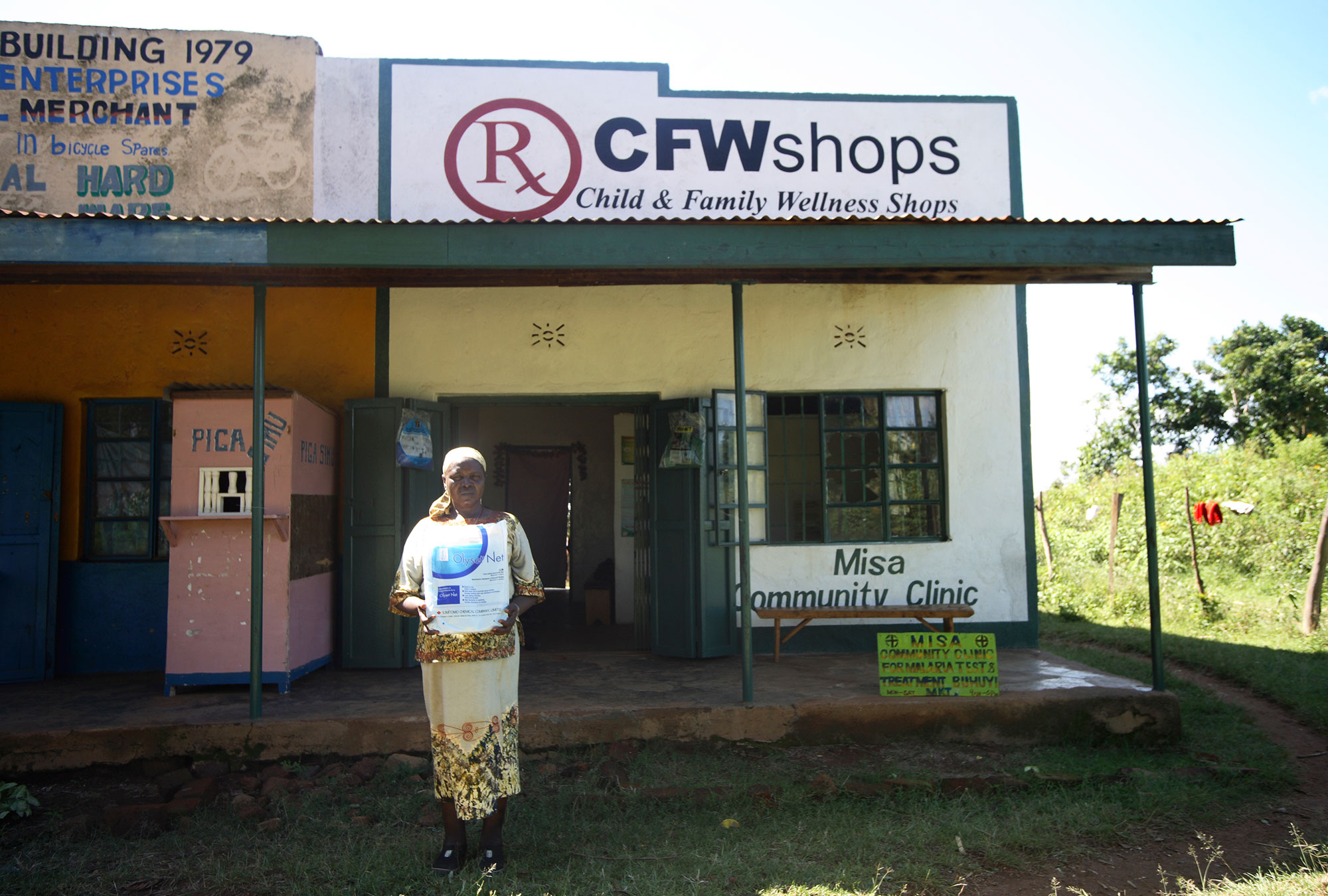 "Woman standing in front of store called ""CFW Shops"""