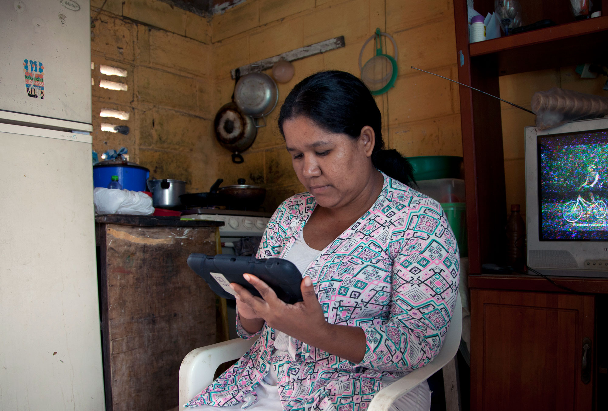 Woman using a tablet.