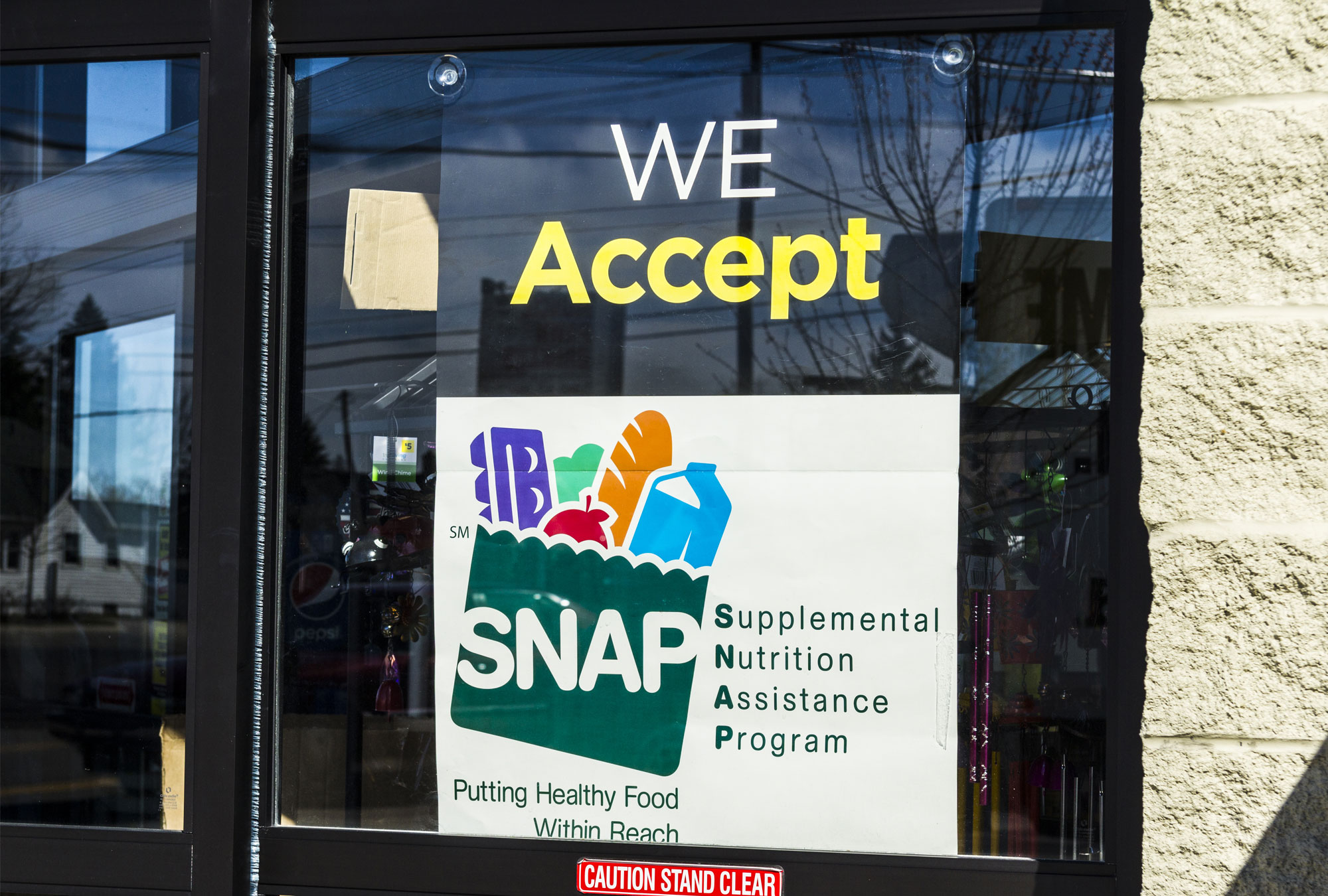 "A Sign at a Retailer - ""We Accept SNAP II"""