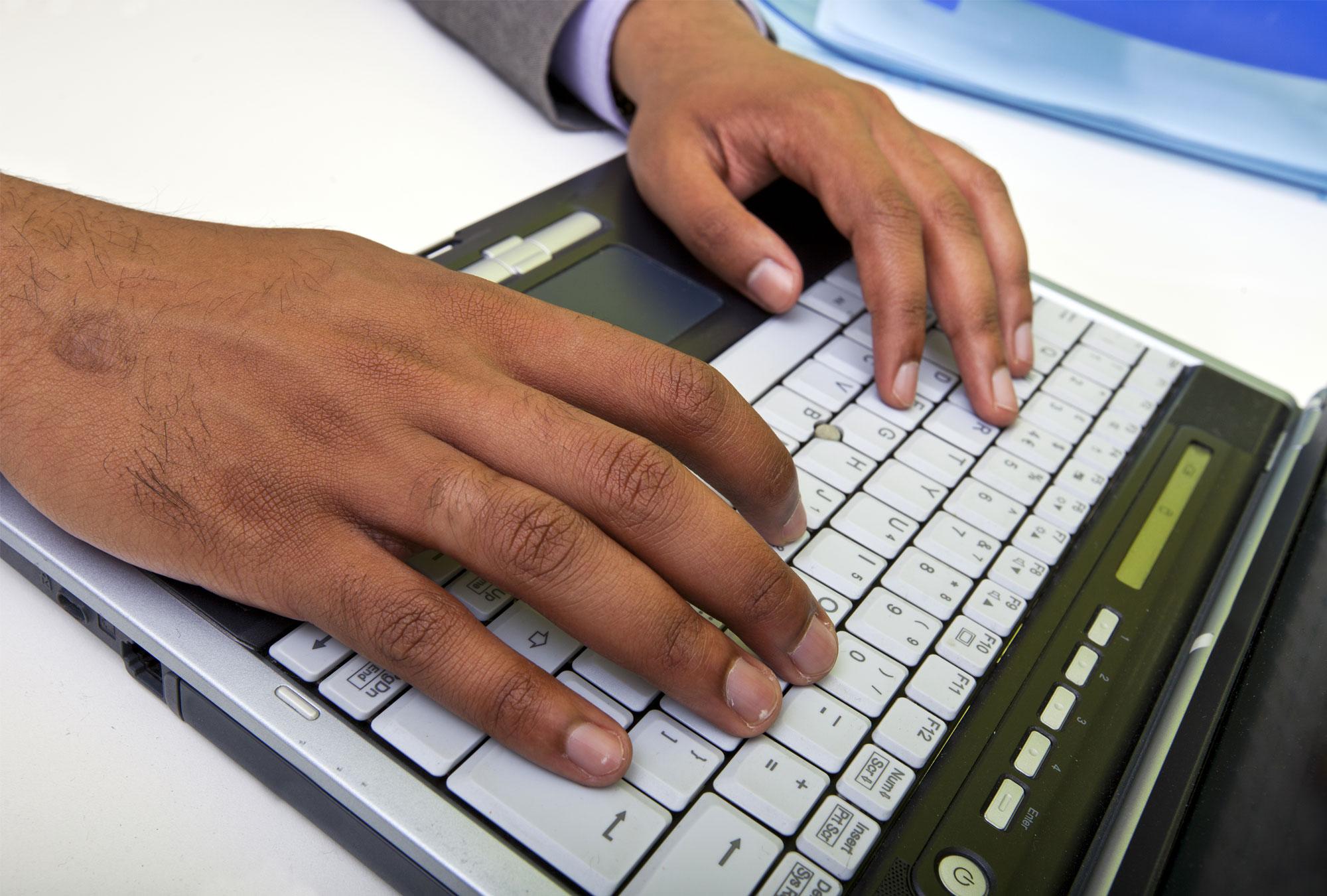 Indian man typing