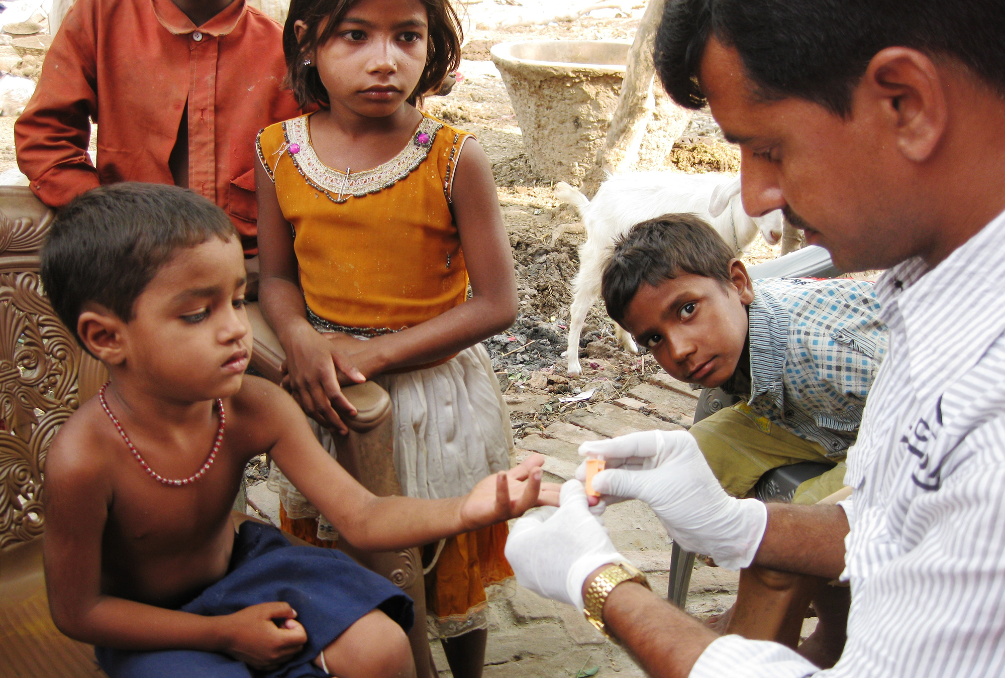 Child having his finger pricked in Bihar, India