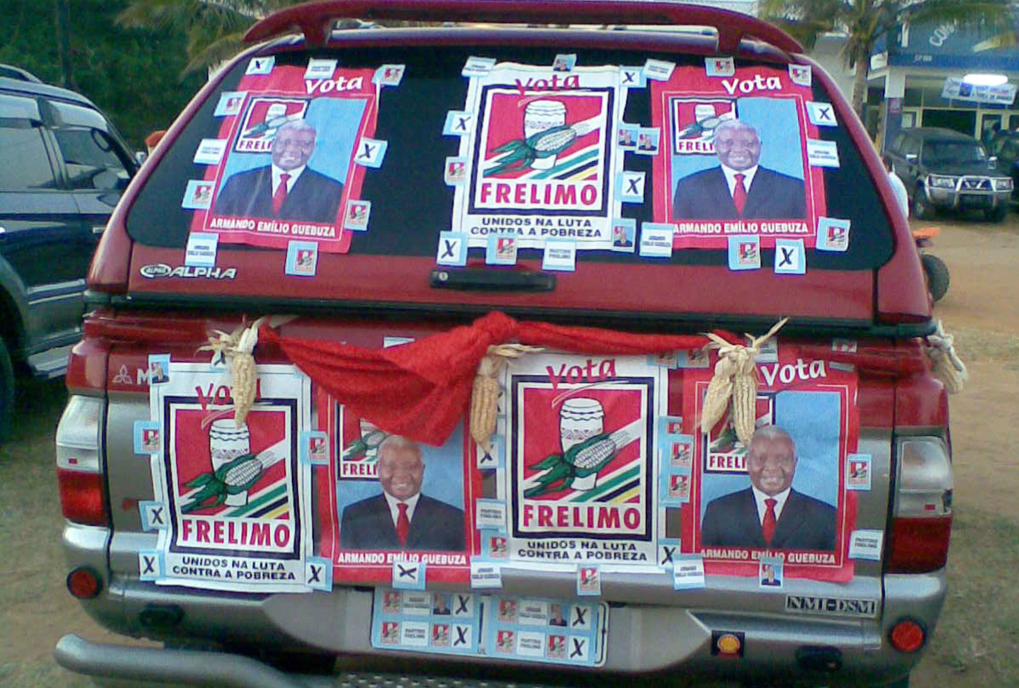 Red car with campaign posters supporting FRELIMO party