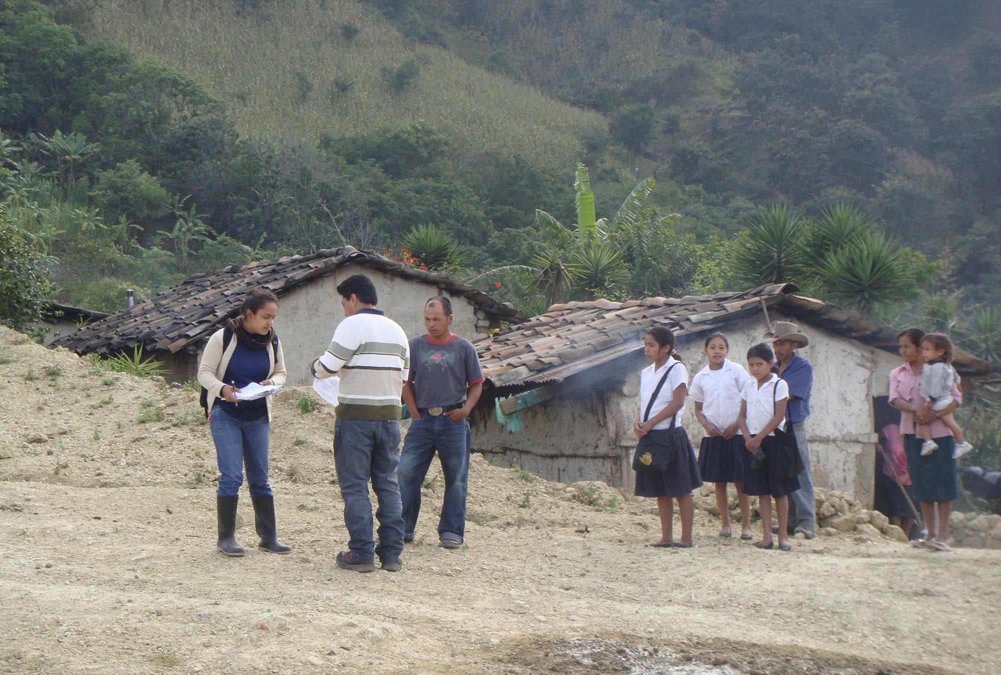 Villagers gather around a survey team in Lempira, Honduras.