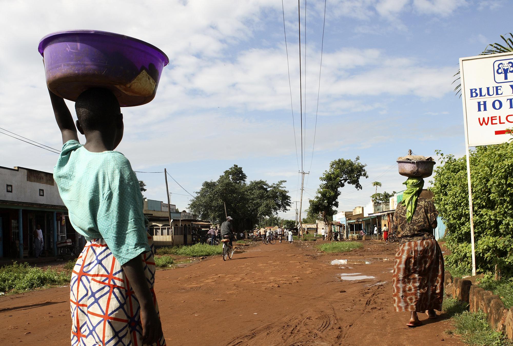 Women carrying food in Tanzania.