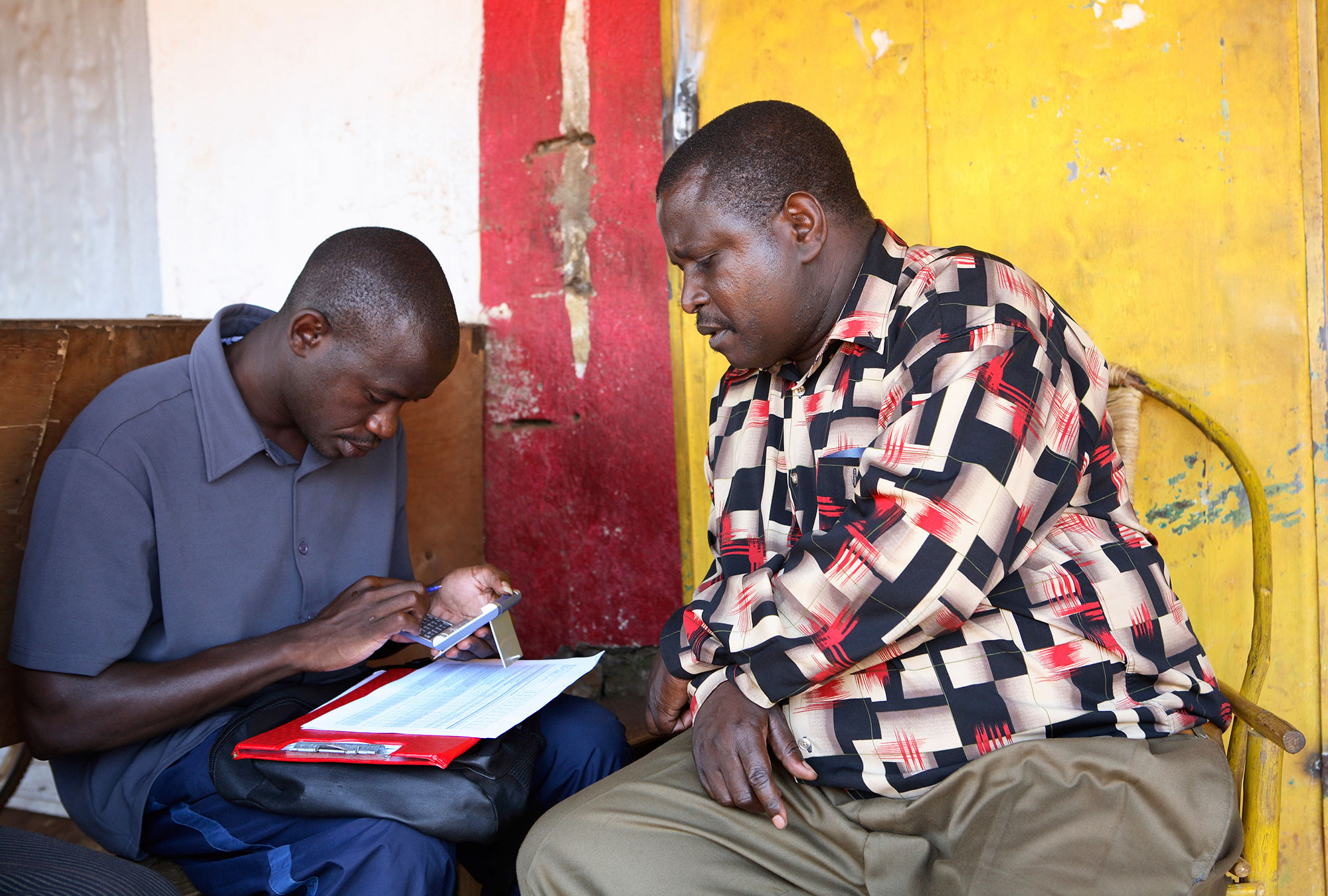 A surveyor adds up the numbers in Nairobi, Kenya