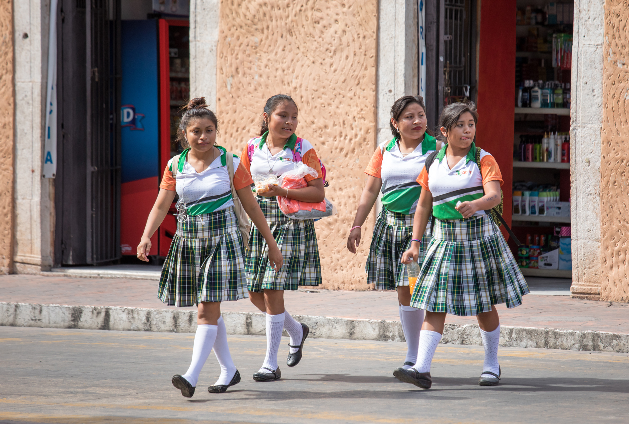 Young girls walking from school