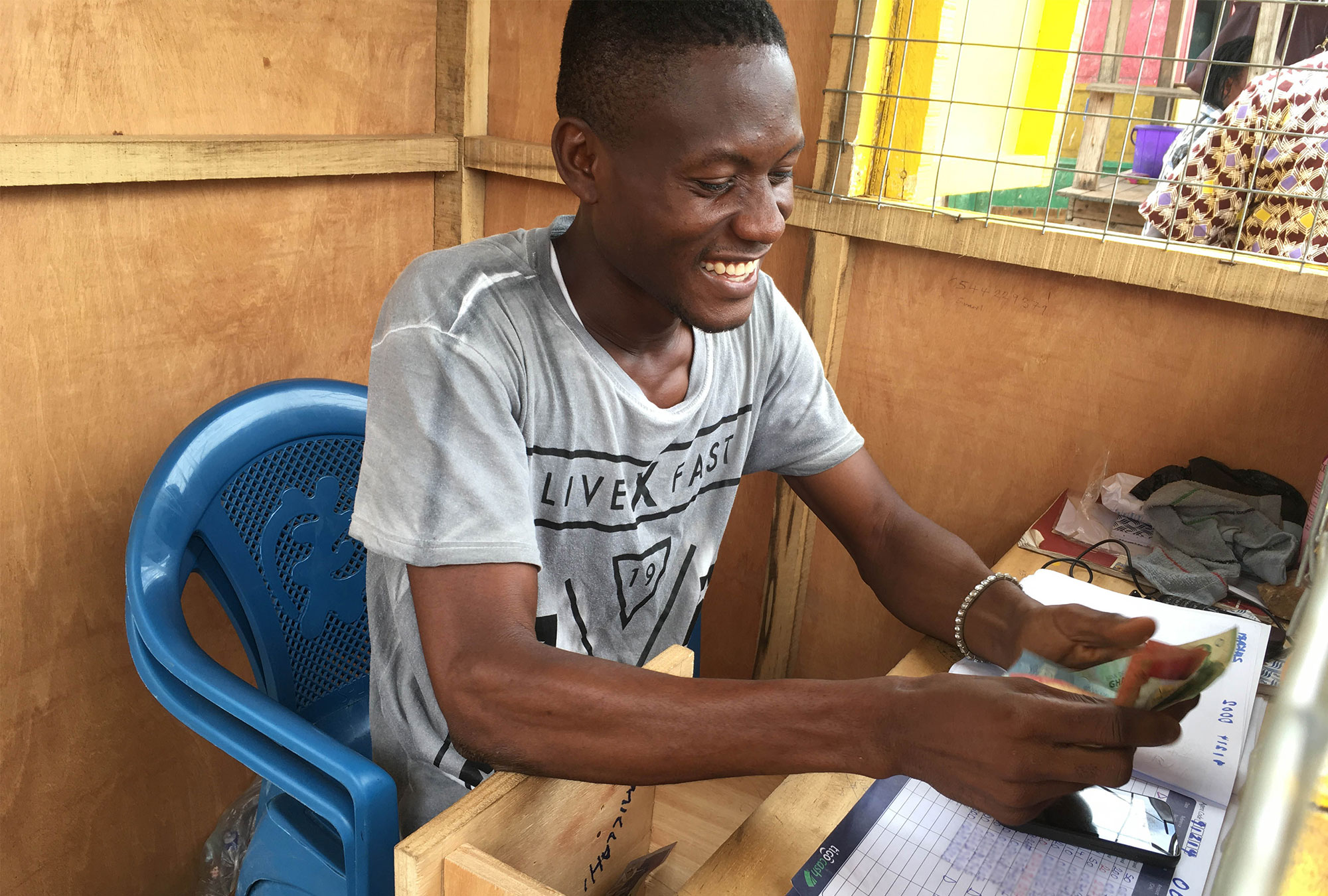 Man smiles while counting money