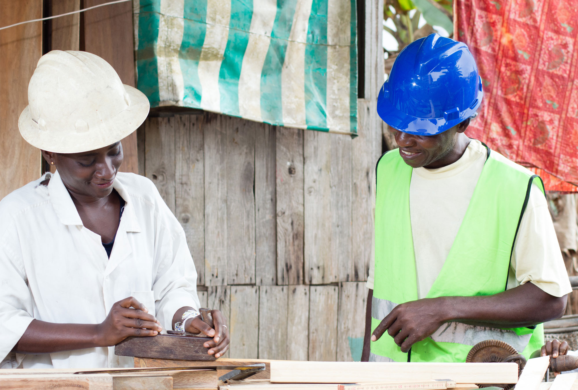 Two people in hard hats at work