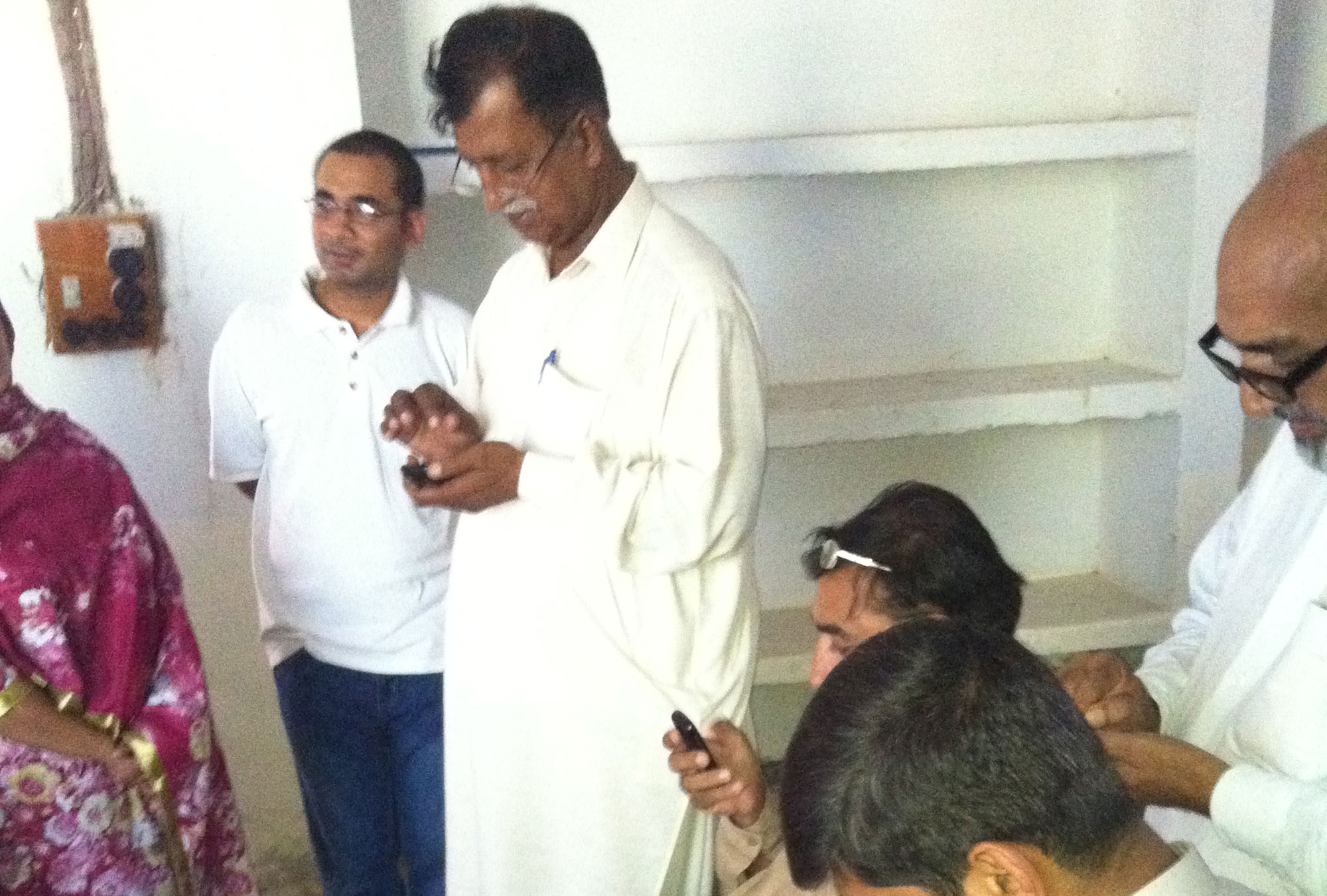 Group of people using phone in Pakistan