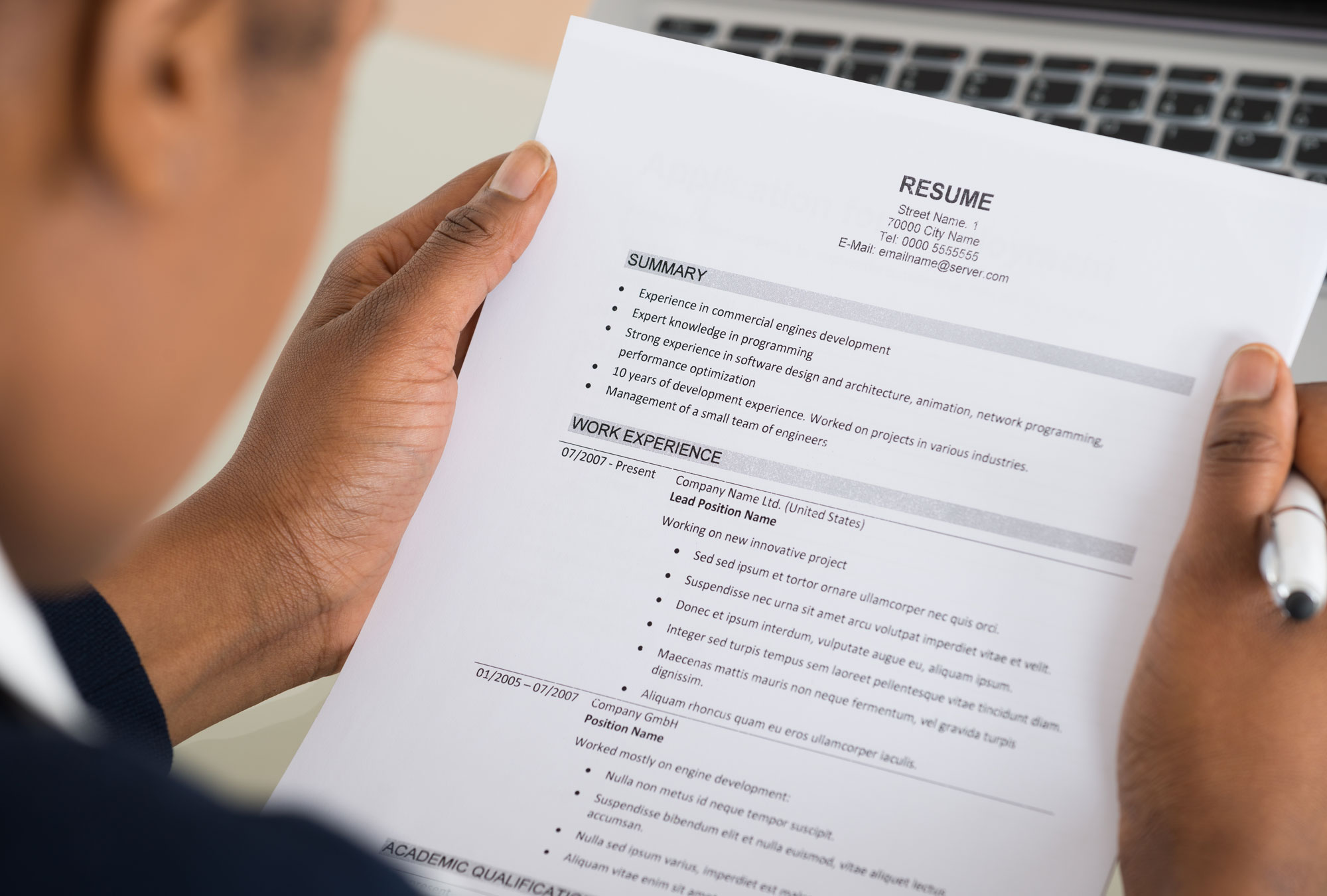 Person holds resume