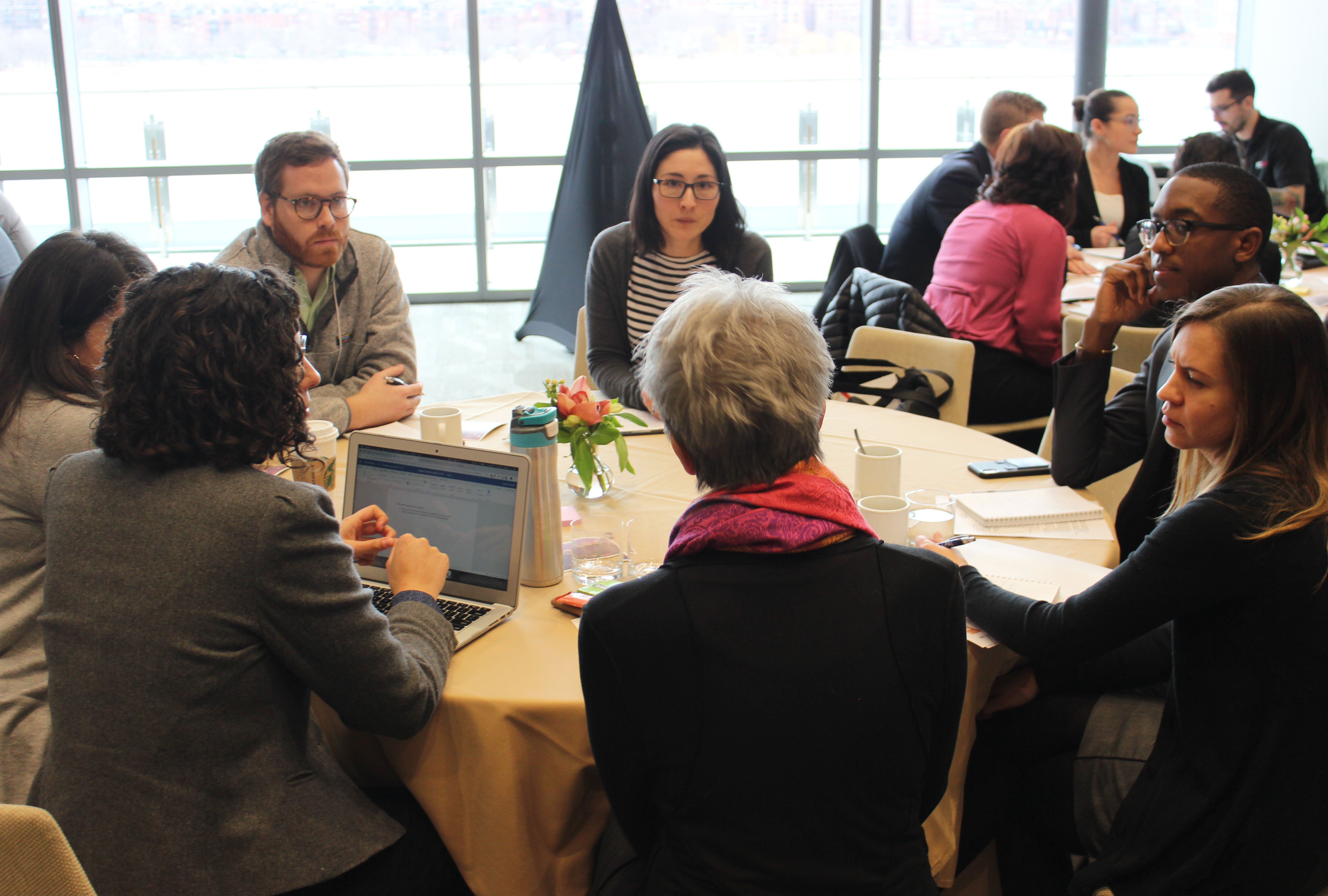 Participants discuss open questions around eight developing evaluations during a breakout session at the year 3 convening