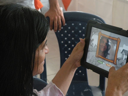 A woman using her tablet in Colombia.