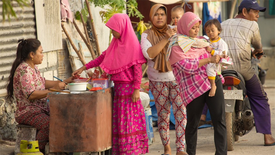 Image: Women at a market in Indonesia.