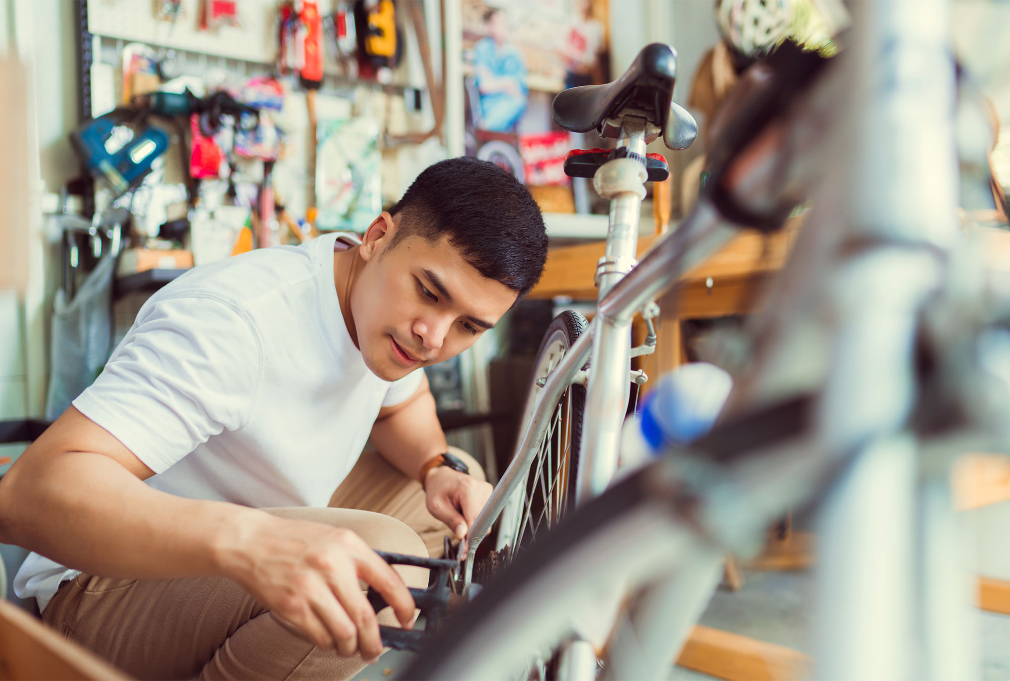 Young man works on a bike