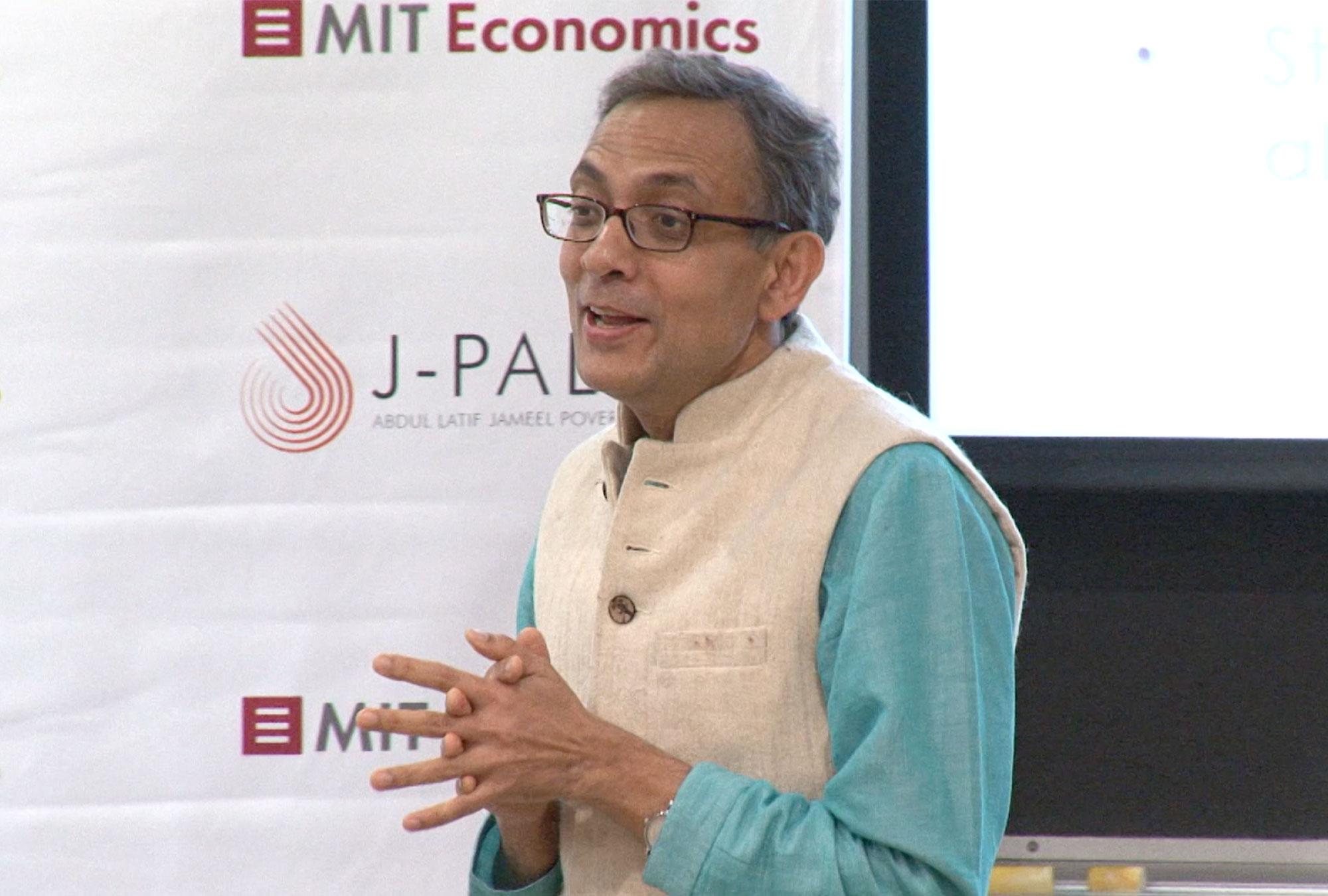 Abhijit Banerjee presenting
