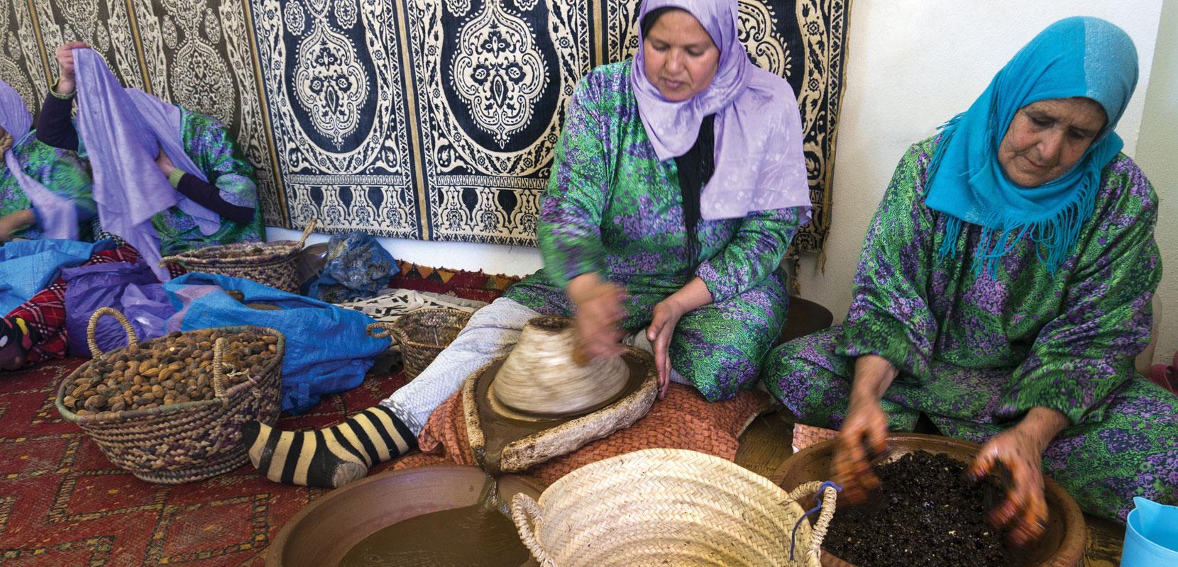 Women processing fruit in baskets