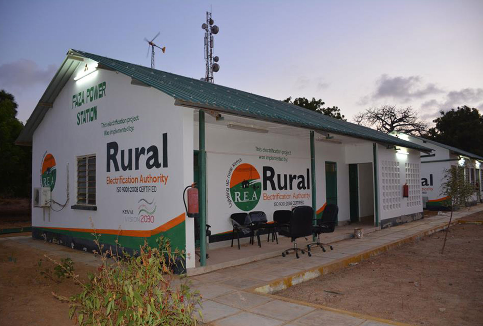 White building with Rural Electrification Authority logo painted