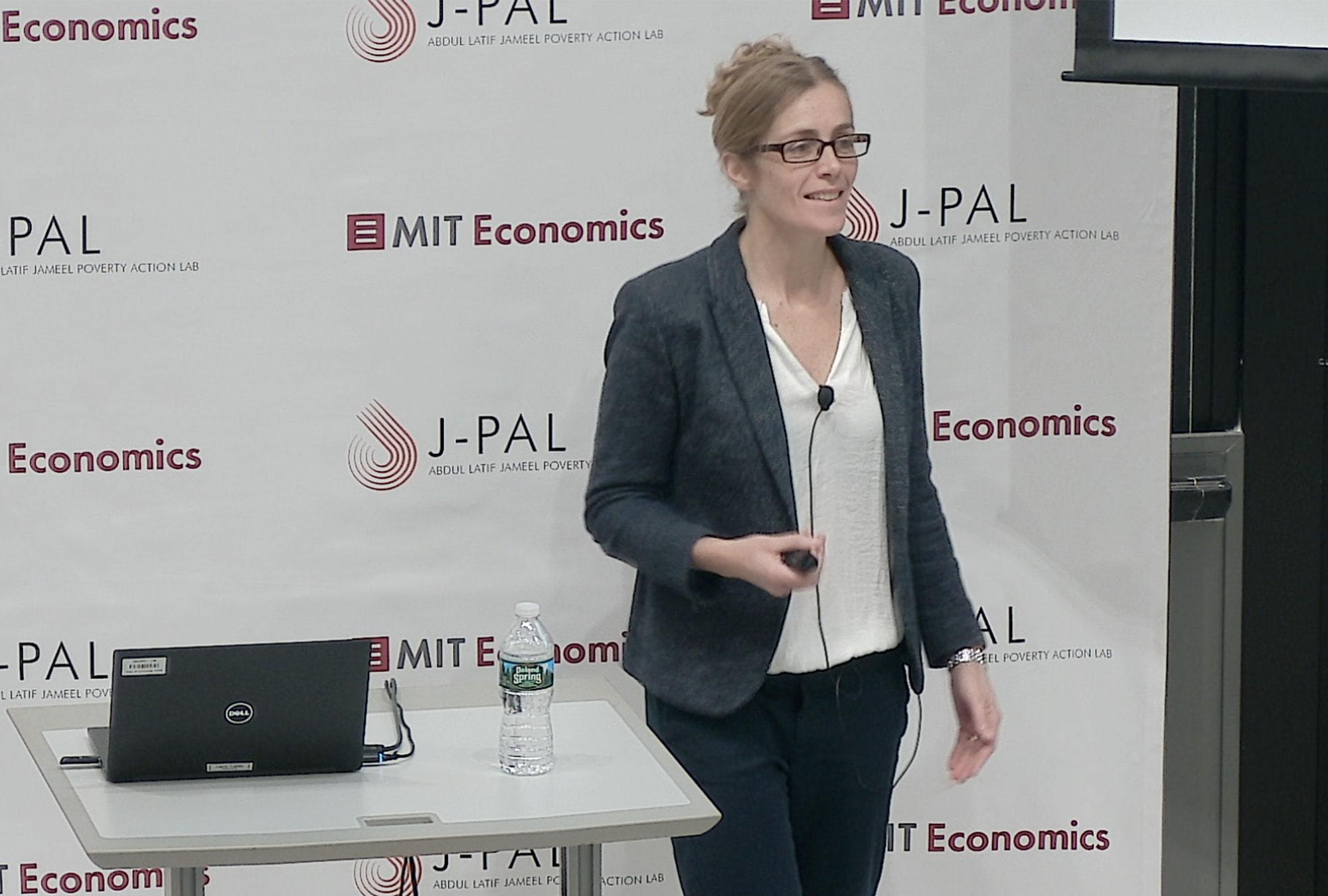 Pascaline Dupas presents at a podium