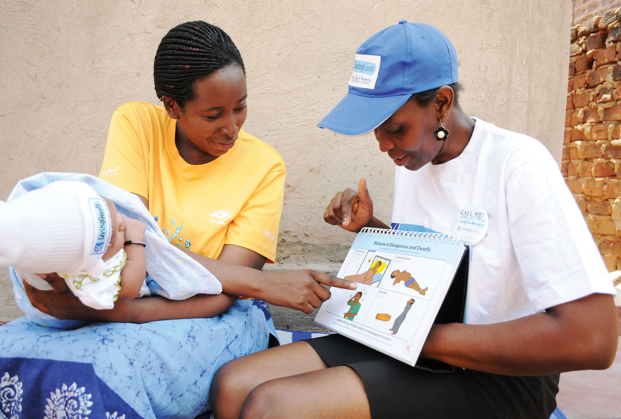 A healthcare worker and mother with a baby in sub-Saharan Africa.