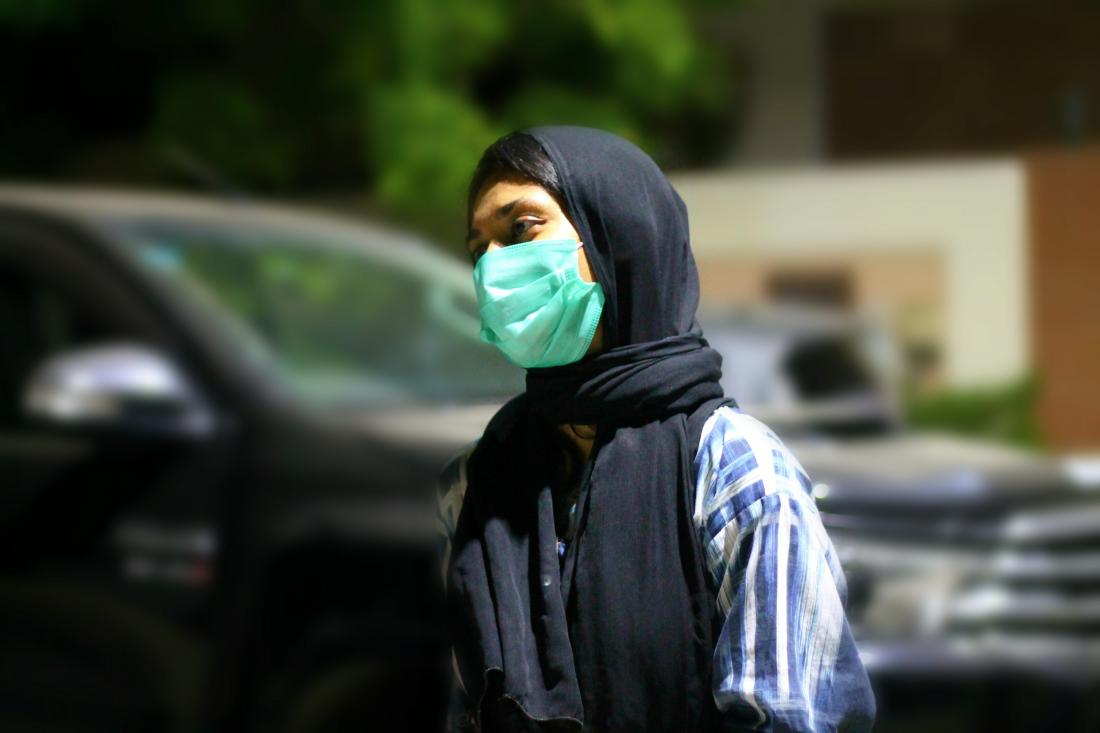 Pakistani woman wearing a face mask to prevent against Coronavirus