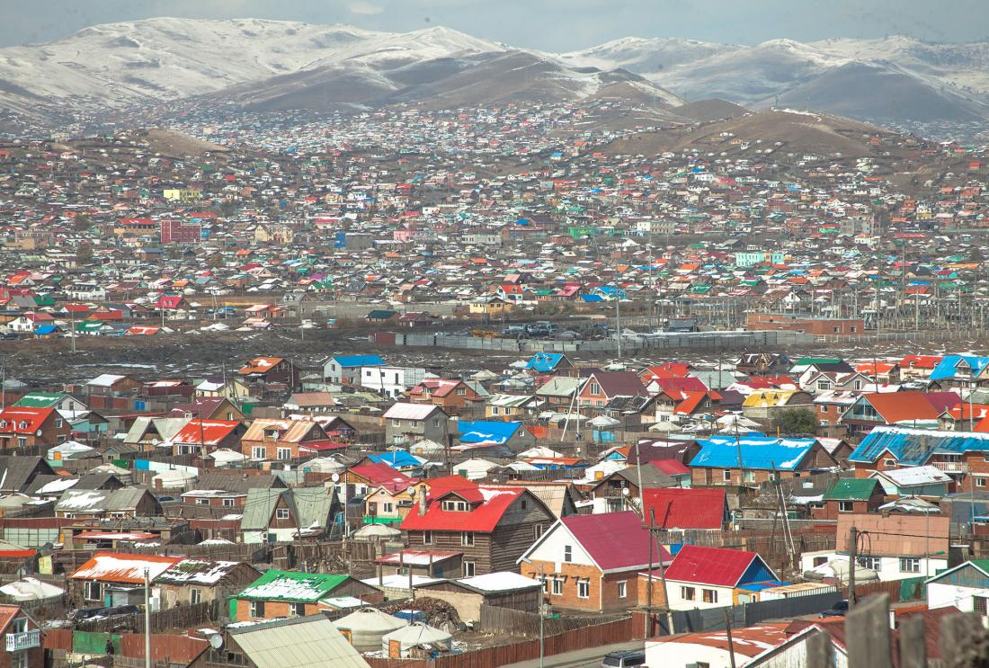 Colorful houses in front of mountain range in Mongolia