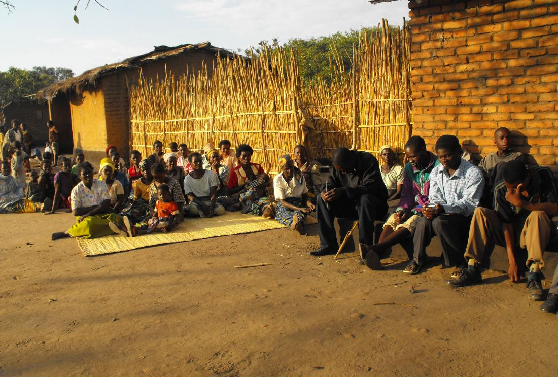 A group of farmers in Malawi learn about sustainable practices
