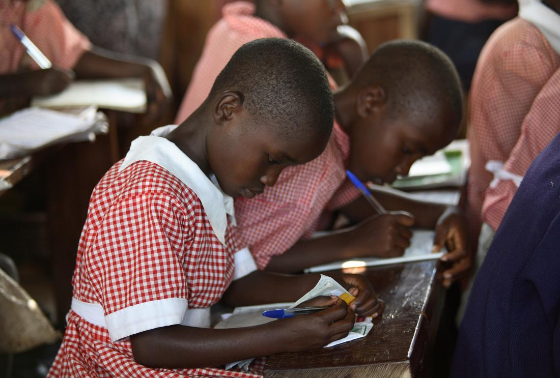 Girls who scored in the top 15 percent on tests received merit-based scholarships, Kenya.
