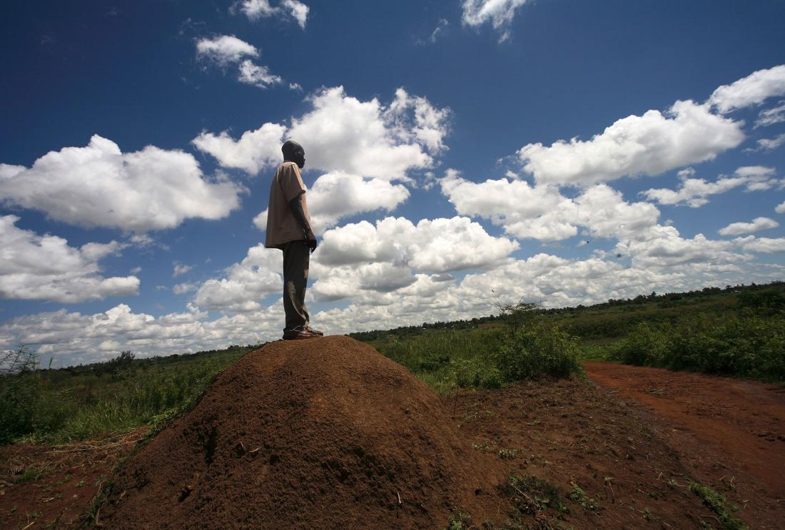 A man is looking out over the land in Kenya.