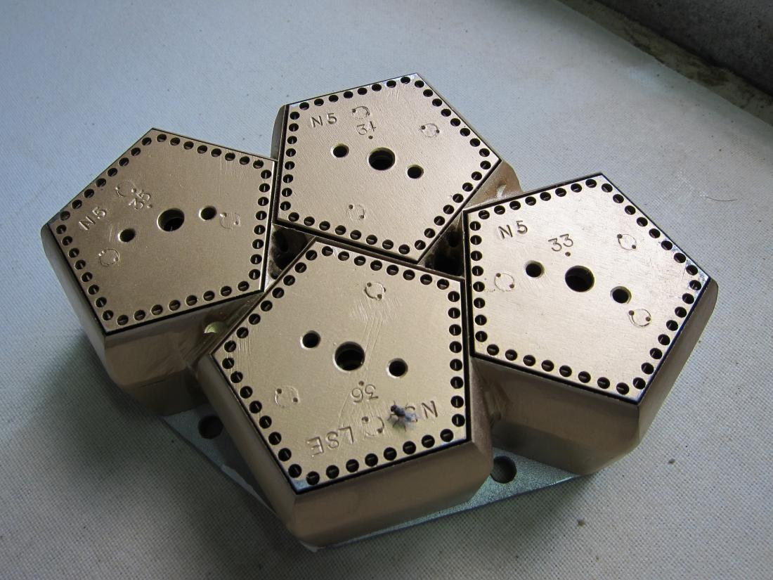 The four-panel offset die that was provided to Tech-Drop firms.