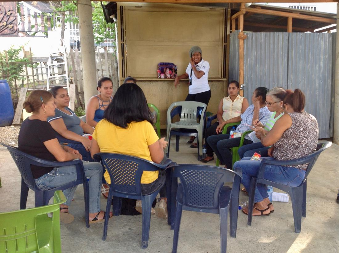 women sit in circle group meeting dominican republic credit score digital