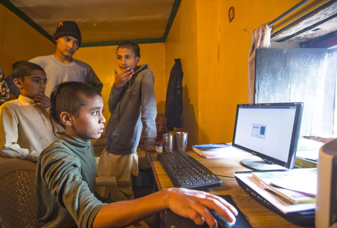 Indian boys sitting at computer