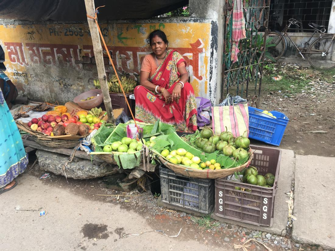 Woman selling produce in Kolkata.