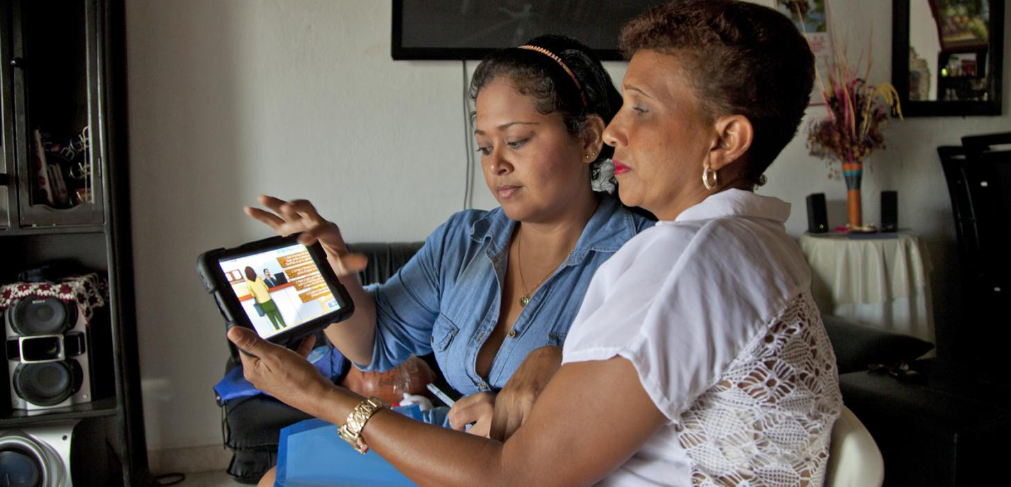 two women looking at a tablet screen