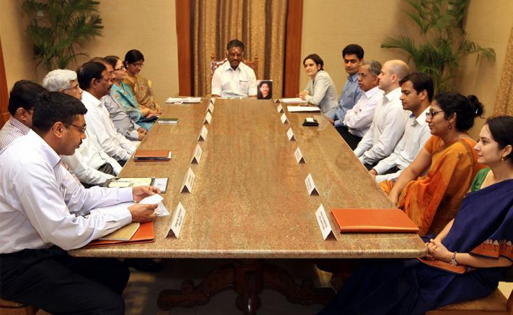 Government officials and J-PAL leadership sit at large table