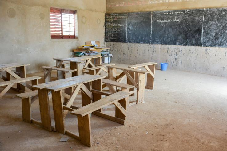 Empty room with wood desks and chalkboard