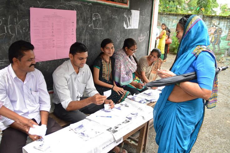Woman voting in India