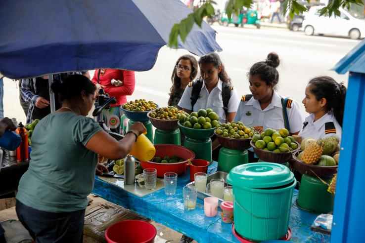 juice vendor and group of female students