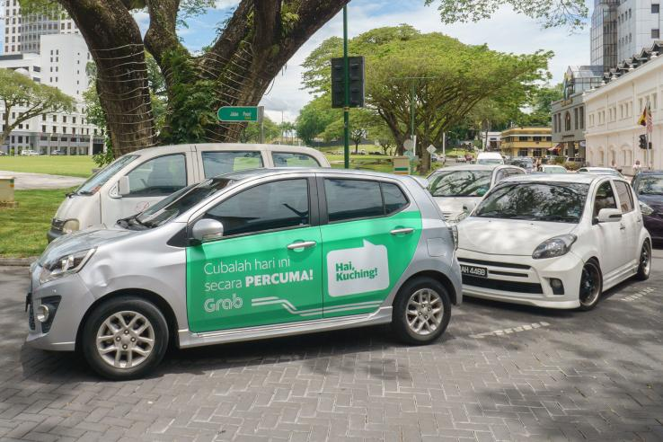 Car with Grab advertisement